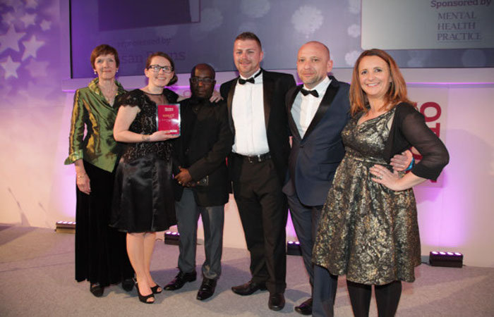 L-R: Sponsor: Caroline Shuldham, Chair, Editorial Advisory Board, RCNi Winners: Practice Development Team, Black Country Partnership NHS Foundation Trust, Susan Burns Godwill Tsvamuno Simon Young Craig Smith Guest Presenter: Lucy Porter, Comedian